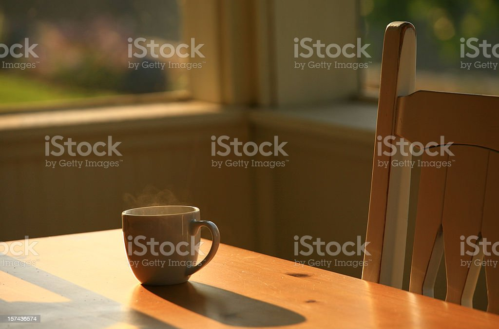 Steaming Morning Coffee on Porch Table stock photo
