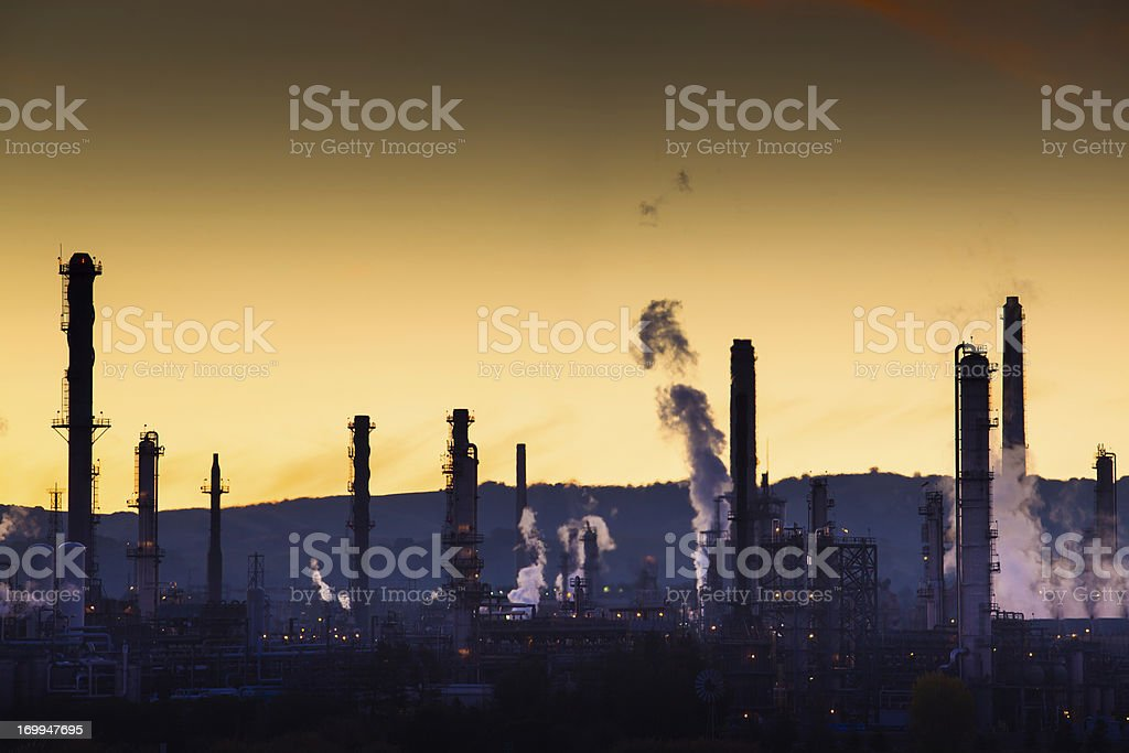 Steaming Oil Refinery at Dusk royalty-free stock photo