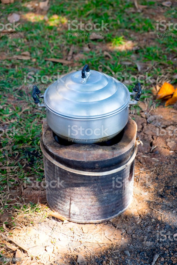 Steaming pot on charcoal stove, outdoor kitchen