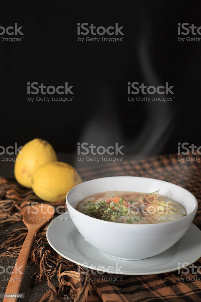 steaming rice soup stock photo