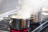Steaming saucepan in the kitchen