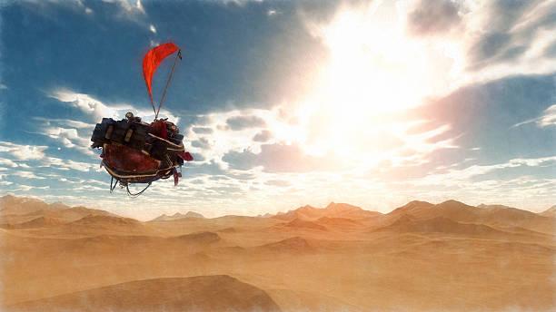 Steampunk airship flying over fantasy desert landscape stock photo
