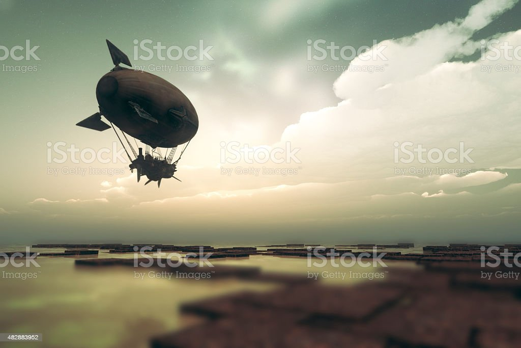Steampunk airship flying over fantasy landscape stock photo