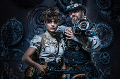 istock Steampunk couple in a studio shot 1195020316