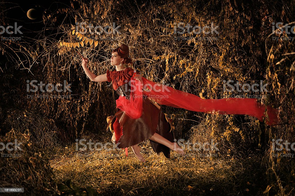 Steampunk Fairy Painting The Last Leaves Of  Fall Golden Yellow royalty-free stock photo