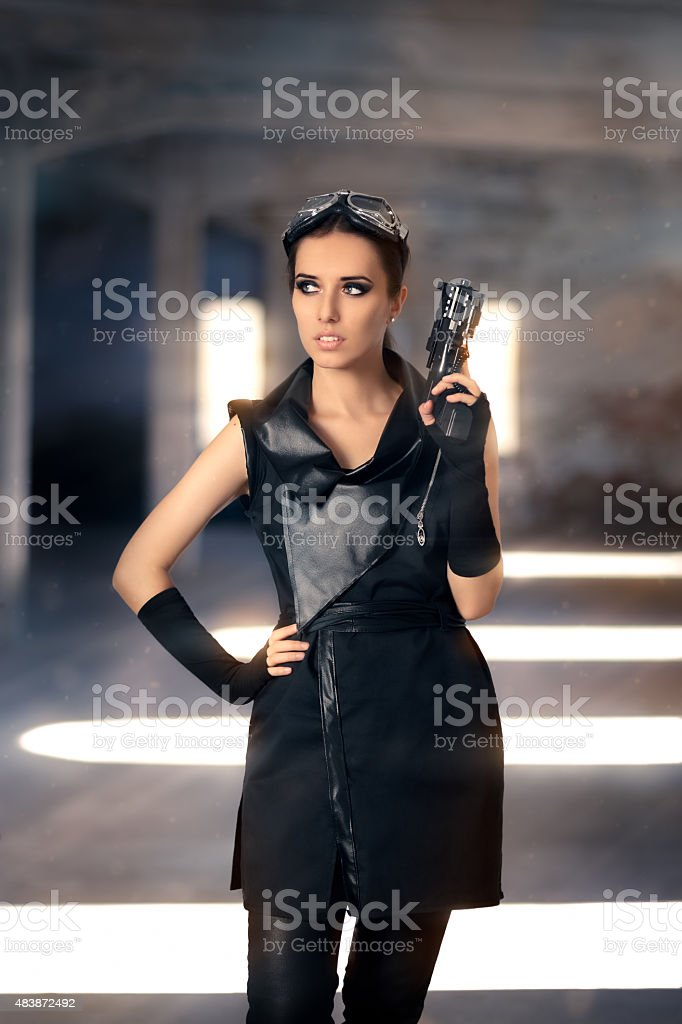 Steampunk Female Warrior with Gun in Post Apocalyptic Ruins stock photo