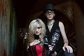 istock Steampunk futuristic couple with gun in an industrial setting 157608053