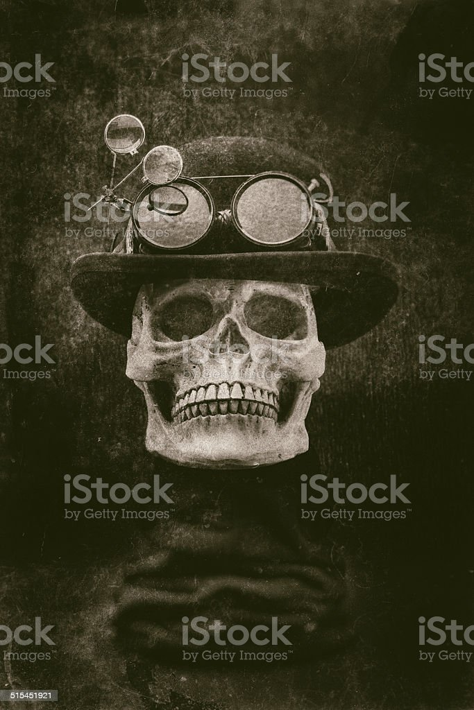 Steampunk halloween skull with bowler hat, goggles grunge effect stock photo