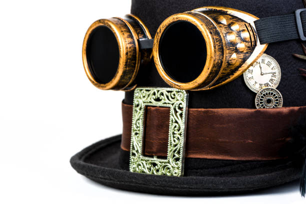 Steampunk hat and goggles in front of white bakground stock photo