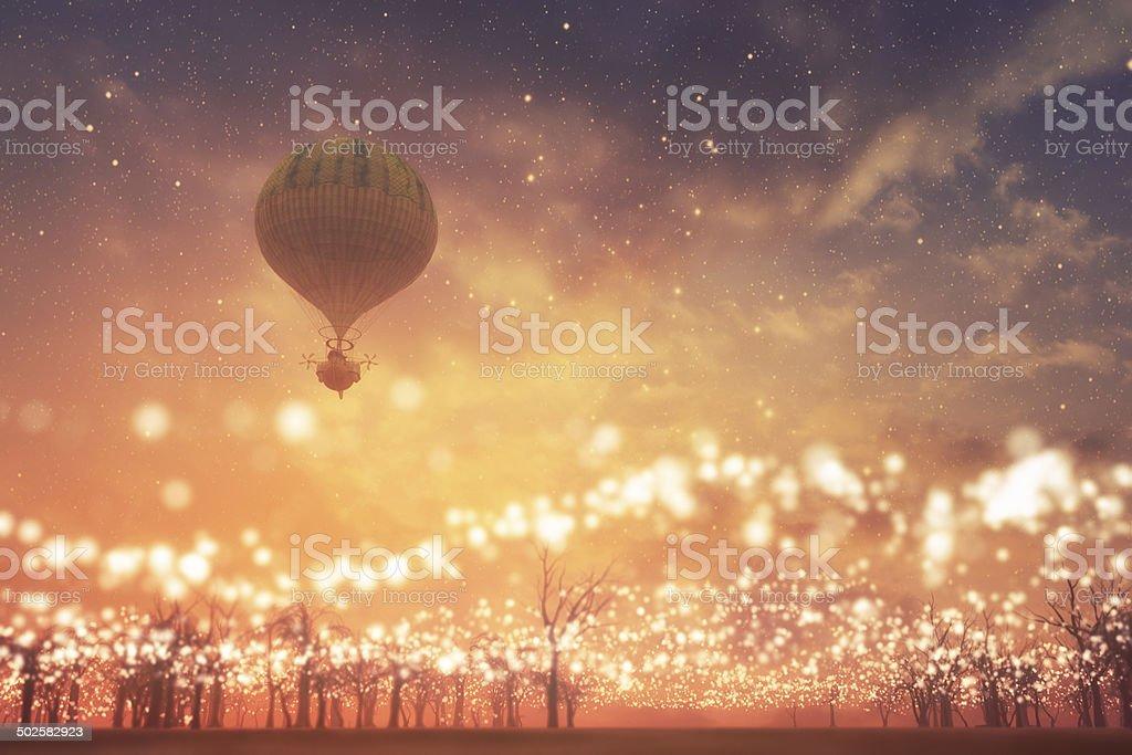 Steampunk hot air ballon flying over fantasy land stock photo