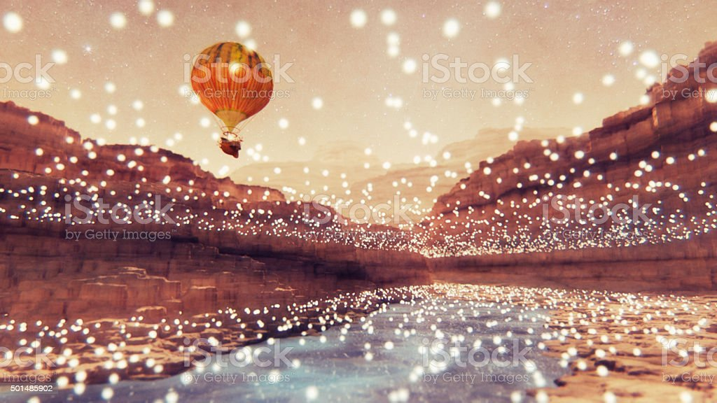 Steampunk hot air balloon flying over fantasy landscape stock photo