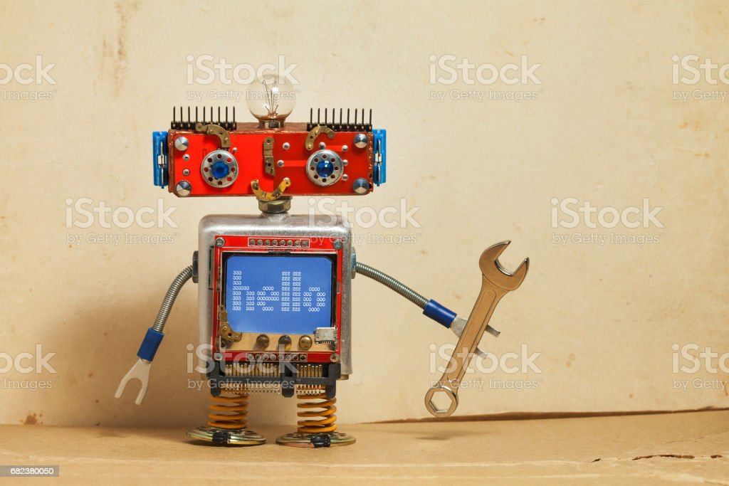 Steampunk machinery robot, smiley red head, blue monitor body. Handyman electrician retro toy, message hello display computer screen, hand wrench. Service repair fix concept. Vintage paper backdrop royalty-free stock photo