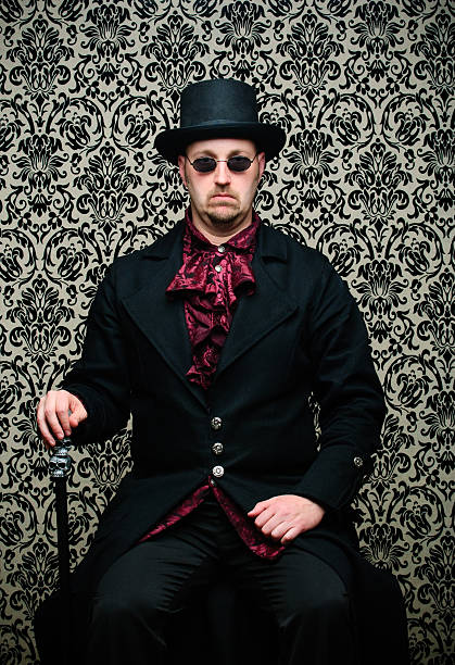 Steampunk Man Sitting Against Damask Background stock photo