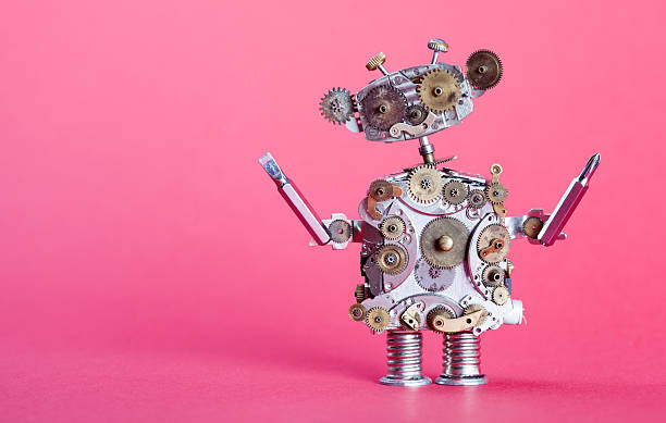 Steampunk service robot concept. Repair man with screw drivers. Aged stock photo