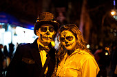 istock Steampunk Skeleton couple pose for passerby. Halloween NYC 2014 522520749