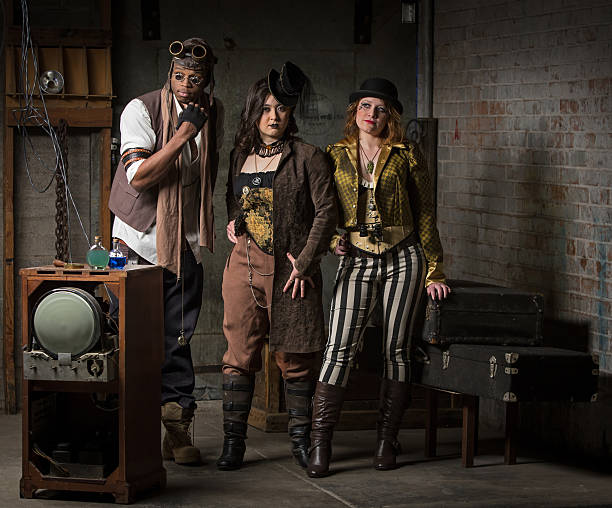 Steampunk Trio Three Young Diverse Steampunks in Retro Lair anachronistic stock pictures, royalty-free photos & images