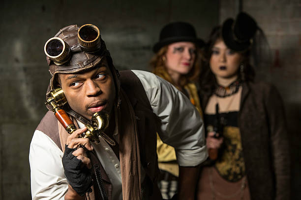 Steampunk Trio Steam Punks in Underground Lair with Retro Phone anachronistic stock pictures, royalty-free photos & images