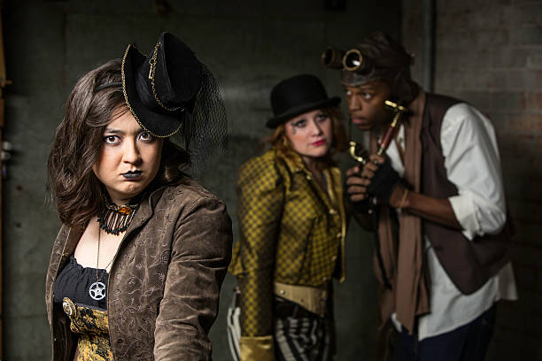 Steampunk Trio Young Steam Punks PosIng in Underground Lair anachronistic stock pictures, royalty-free photos & images