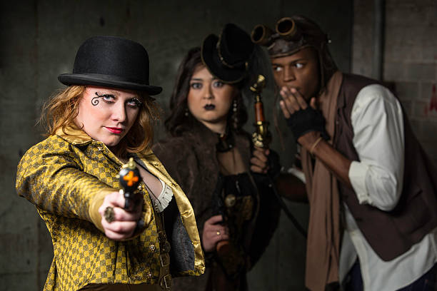 Steampunk Trio Steam Punks in Underground Lair with Weapon anachronistic stock pictures, royalty-free photos & images