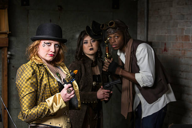 Steampunk Trio Steam Punks in Underground Lair with Weapons anachronistic stock pictures, royalty-free photos & images