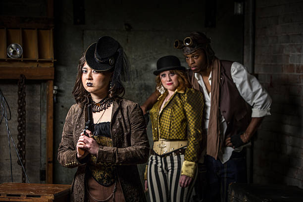 Steampunk Trio with In Retro Lab Three Steampunks with in Underground Retro Lab anachronistic stock pictures, royalty-free photos & images