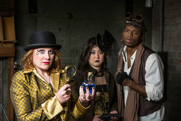 Steampunk with Magnifying Glass Steam Punks in Underground Lair with Potion and Magnifying Glass anachronistic stock pictures, royalty-free photos & images