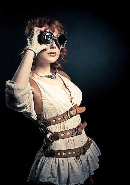 steampunk woman looking over her goggles - steampunk stock photos and pictures