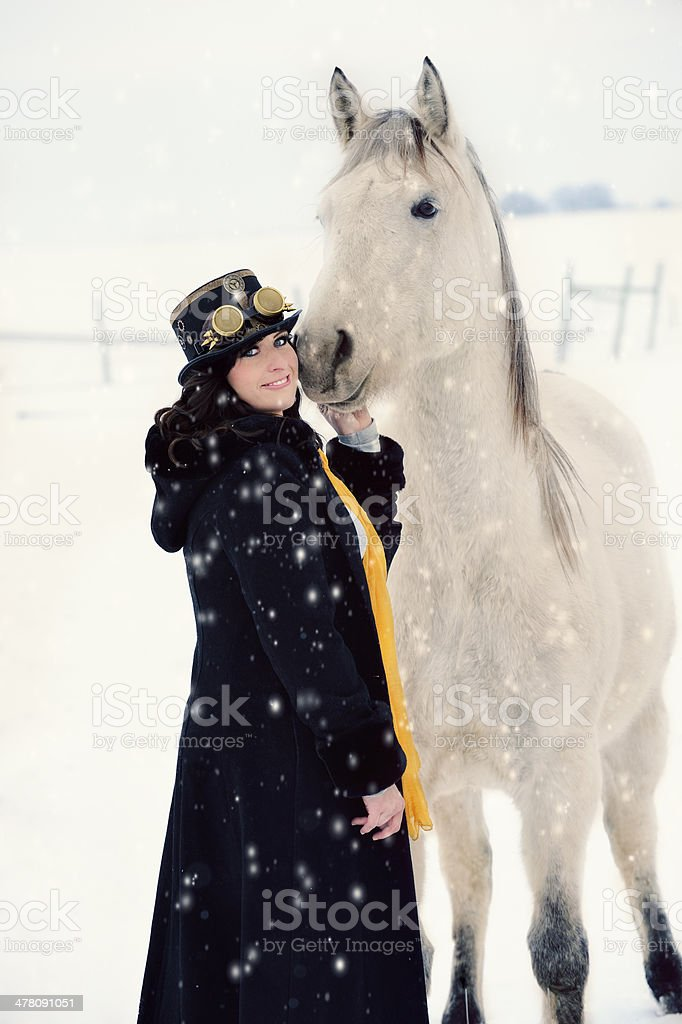 Steampunk Woman With White Horse - Snowy Day royalty-free stock photo