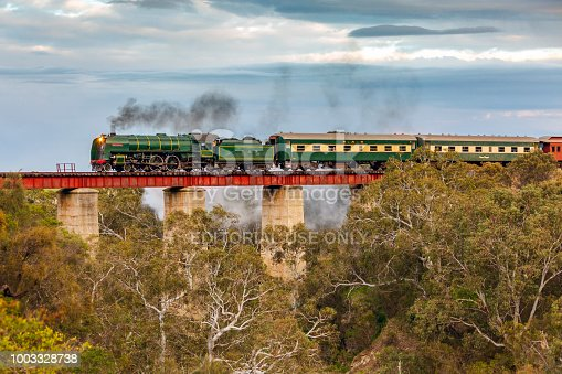 Currency Creek, Australia, July 15, 2018: Preserved SAR steam locomotive 621 crosses the iconic Currency Creek bridge with the Steamranger Southern Encounter tourist train as it returns from an excursion tour to Goolwa and Victor Harbor.
