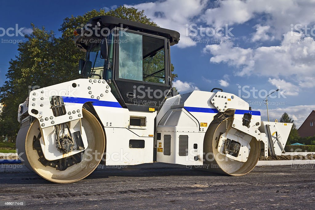 Steamroller on a new road construction stock photo