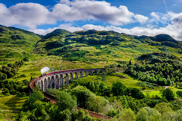Steamtrain on the Glenfinnan Viaduct Steamtrain on the Glenfinnan Viaduct. This is the Viaduct that was used in the Harry Potter movies.  scottish highlands stock pictures, royalty-free photos & images