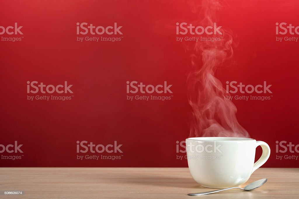 Steamy rising from a large cup of coffee or tea
