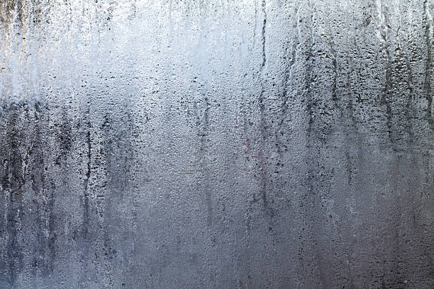 steamy window with water drops - condensation stock photos and pictures