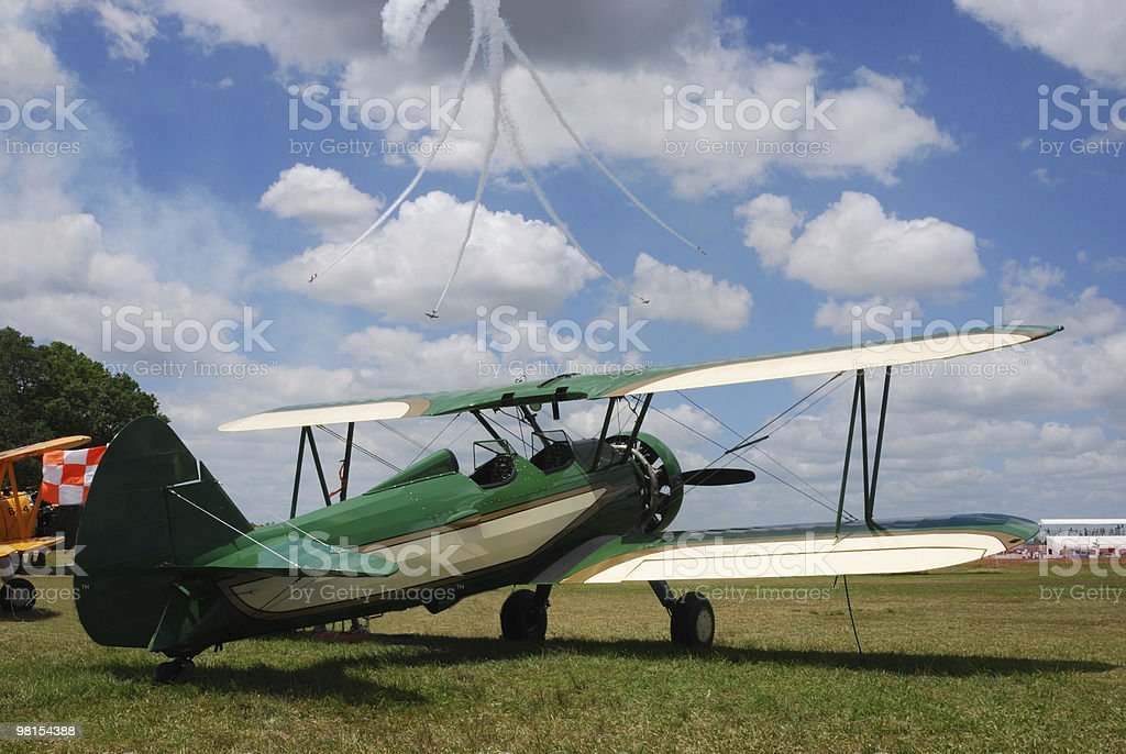 Stearman Aircraft with Stunt Planes in Background royalty-free stock photo
