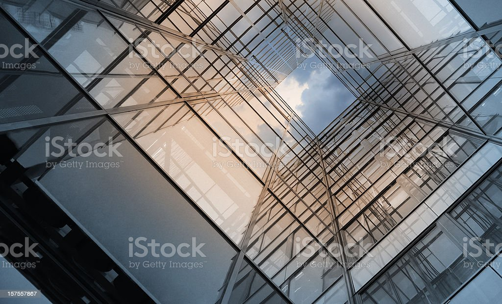 Steel and glass finance building into clouds royalty-free stock photo