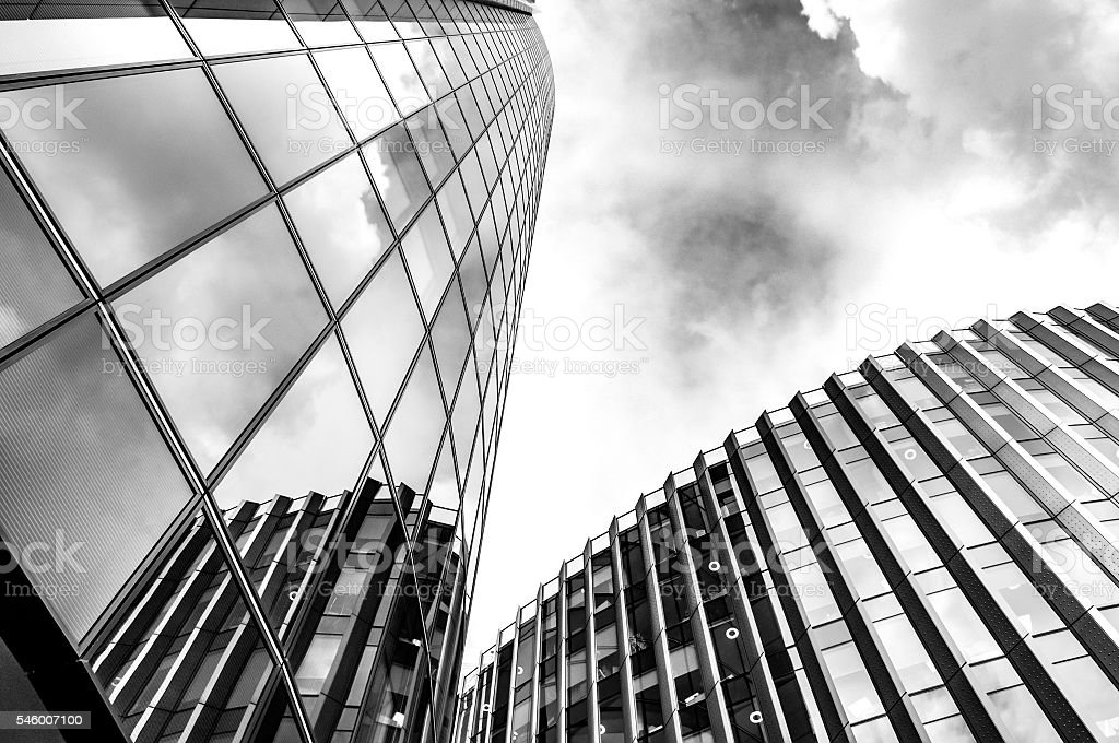 Steel and glass skyscrapers of London against a cloudy sky stock photo