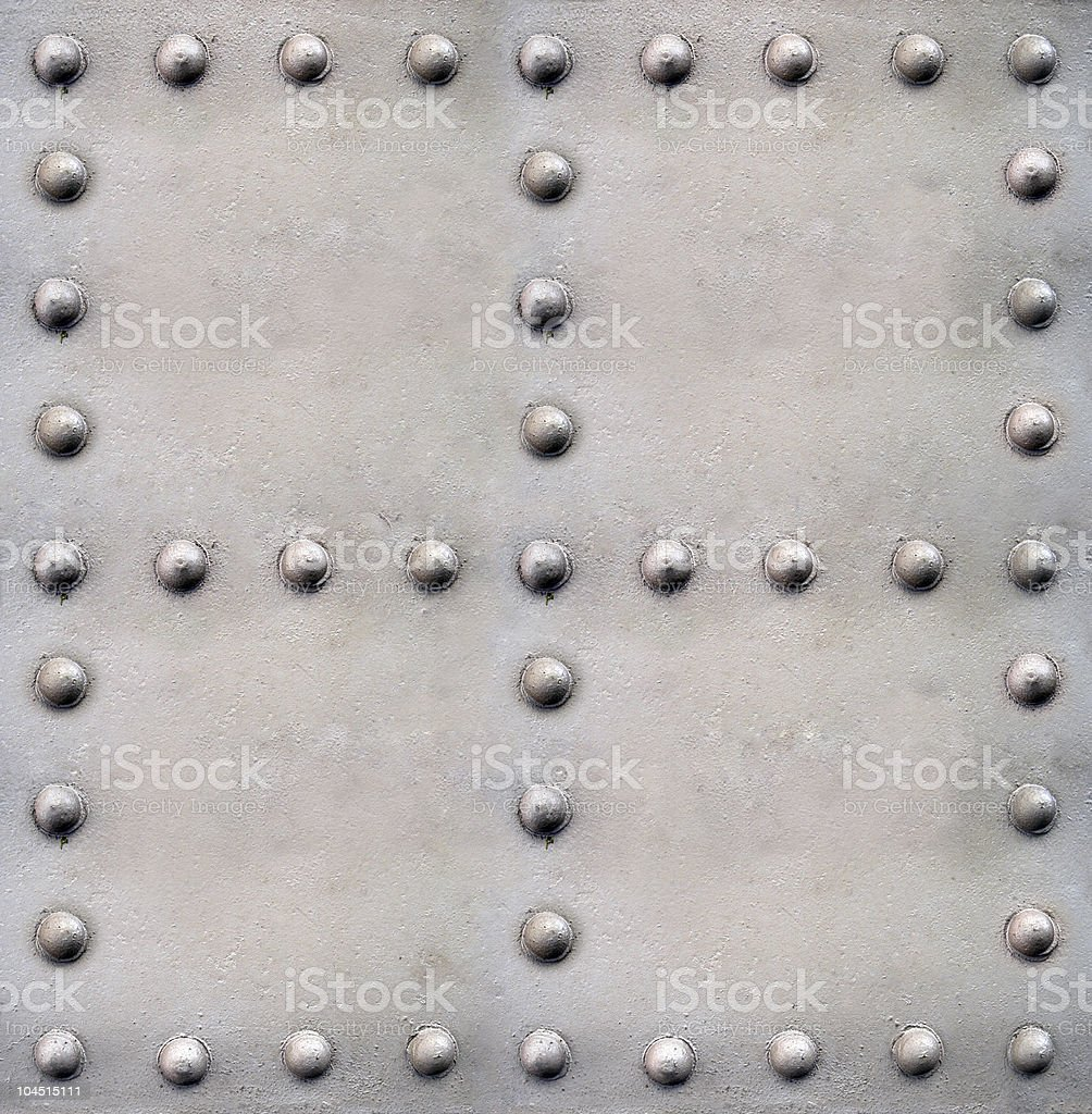 A steel background with lots of rivets stock photo