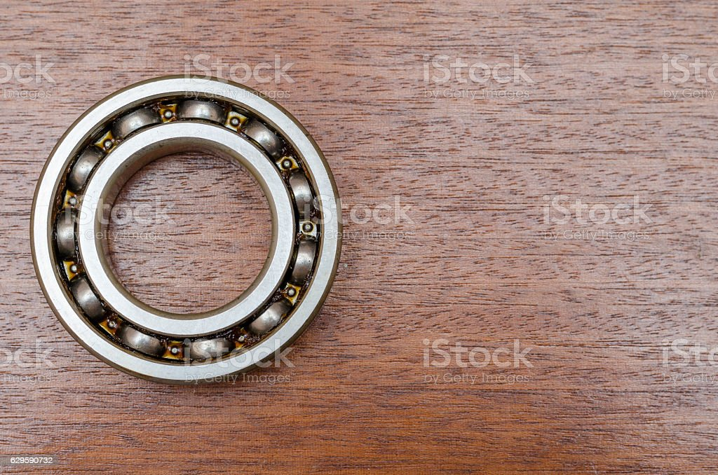 steel ball bearings on wooden table stock photo