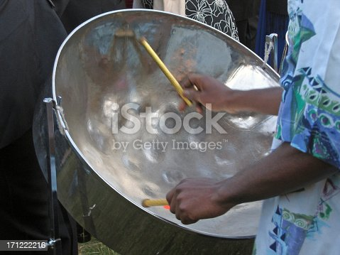 A man playing a steel drum.Please click below for another picture from this series: