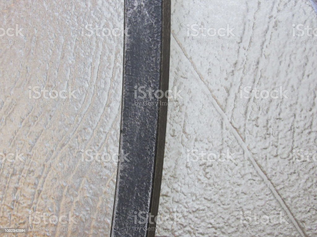 Steel Bar Against Concrete Wall stock photo