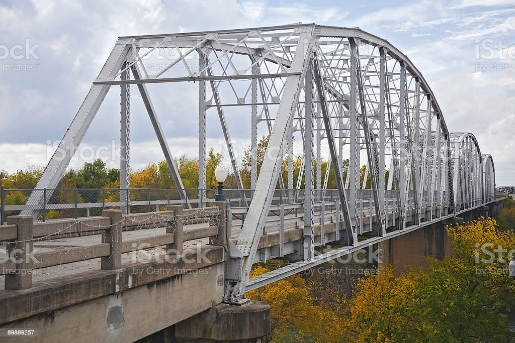 steel bridge against cloudy sky royalty-free stock photo