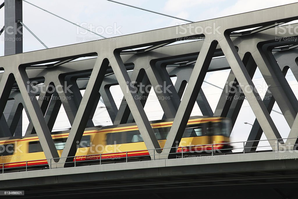Steel bridge over river Rhine with tramway stock photo