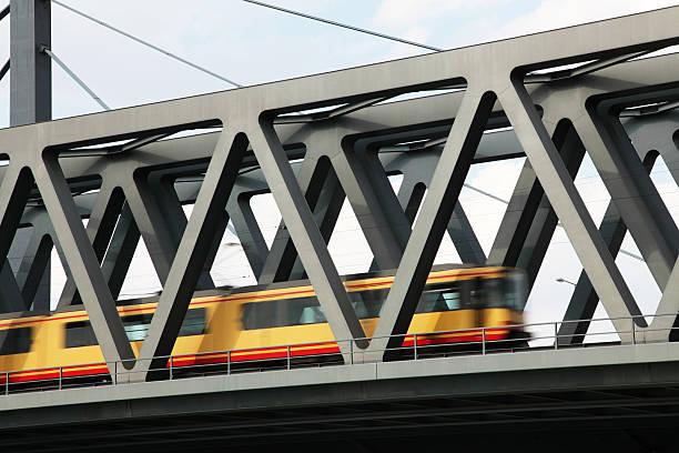Steel bridge over river Rhine with tramway stock photo
