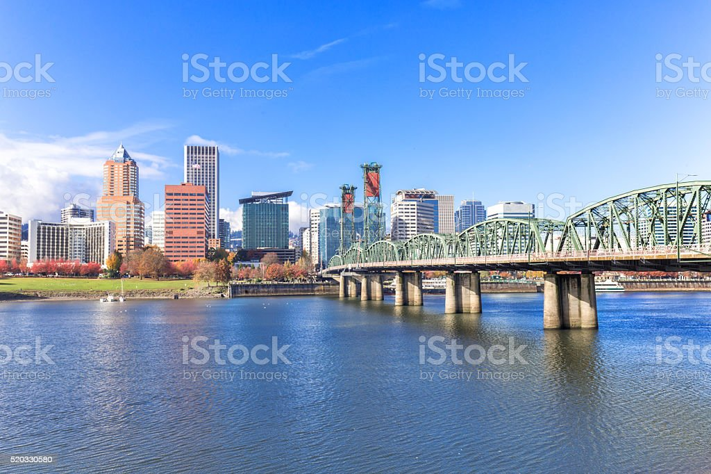 steel bridge over water with cityscape and skyline in portland stock photo