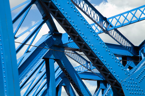 Graphic close up of steel girders from bridge