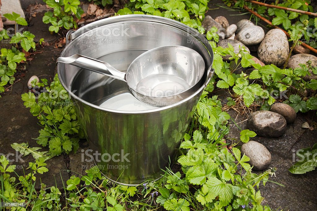 Steel bucket  full of frech sparkling water. royalty-free stock photo