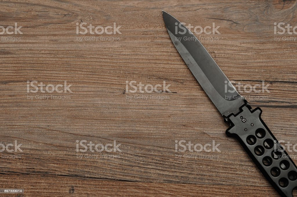 Steel butterfly knife (balisong) stock photo