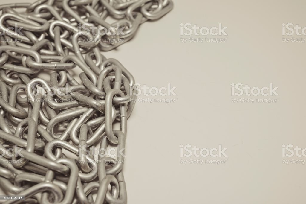 Steel chain heap - abstract metal background. stock photo