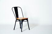 Steel chair with light wood
