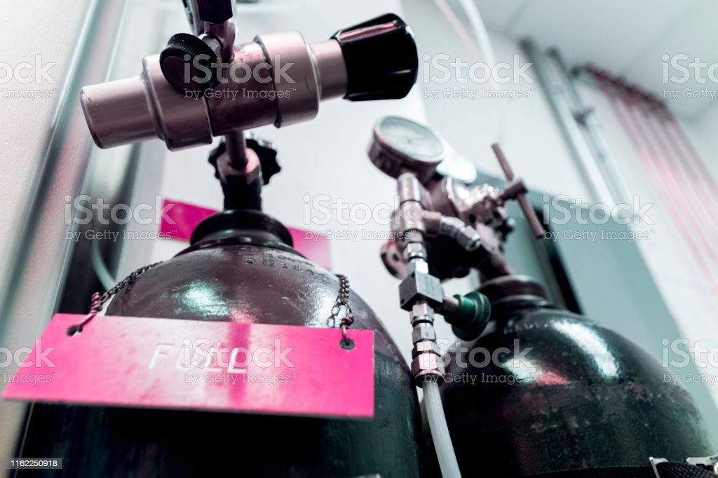 These metal cylinders or bottles hold various gasses used by...
